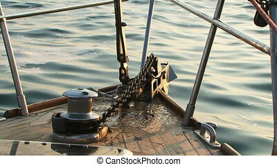 Raise anchor - Powered hoist anchor on a small yacht.