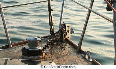 Raise anchor - Powered hoist anchor on a small yacht.