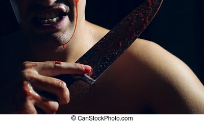 A mad man, a gripping knife, covered in blood, the hands of...
