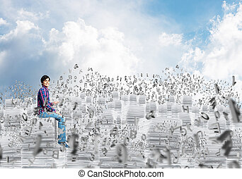 Attractive man sitting on pile of paper documents. - Young...