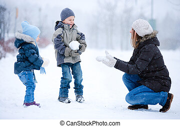 Family fun outdoors at winter - Mother and two kids having...