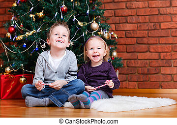 Brother and sister near Christmas tree - Brother and sister...