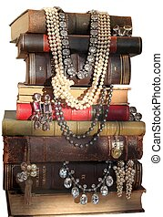 Jewelry and the books - Old - fashioned jewelry lays between...