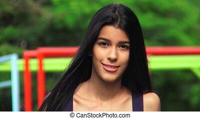 Pretty Hispanic Teen At Playground