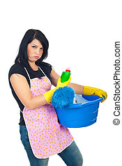 Miffed woman holding cleaning products isolated on white...