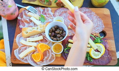 Tasty italian food. Fresh bruschettes, cheeses and meat on...