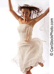Dancing Bride - Happy Bride dances on white studio...