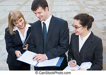 Acquaintance with business plan - Smiling young women...