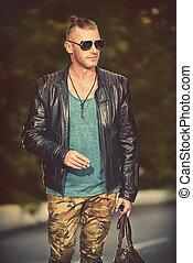 lover of adventure - Handsome brutal man in leather jacket...