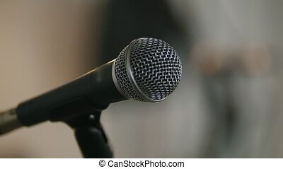 Stage with microphones in loft or audience, close up