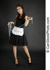 Woman in maid costume with chain