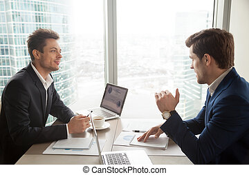 Financial consultant explaining plan to investor - Two...