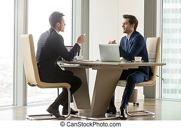 Successful entrepreneurs analyzing perspectives - Two...