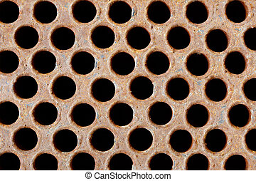 Rusty iron grate - element of industrial heat exchanger -...