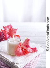 Spa flowers and candles - Spa flowers, towels and candles on...