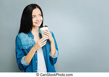 Relaxed girl drinking tasty coffee - Coffee time. Charming...