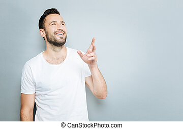 Positive male person raising left arm - It is here. Happy...