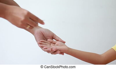 Hand of young mother giving paper card house to daughter...
