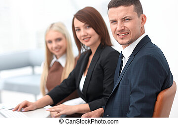 closeup of business people sitting at a meeting the...