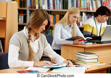In library - Portrait of clever students preparing lessons...