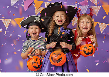kids at halloween - Happy brother and two sisters at...