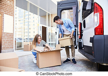 Family Moving House - Portrait of happy young family with...