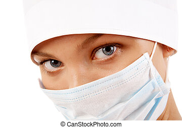 Nurse - Face of nurse in sterile mask looking at camera over...