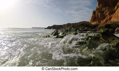 Videography of the surface of waves on the beach. In Summer