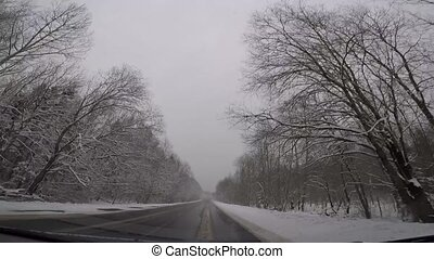 Driving a car in bad winter weather