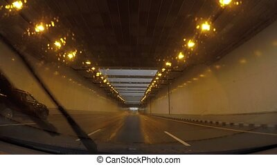 driving by car through the tunnel