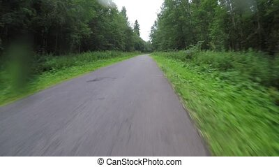 cycling through the forest. POV video