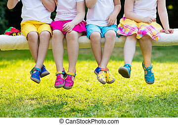 Kids with colorful shoes. Children footwear - Footwear for...