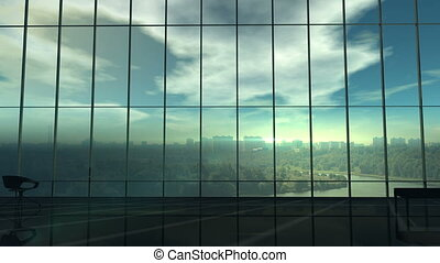 Silhouette of a businessman against the huge office window -...