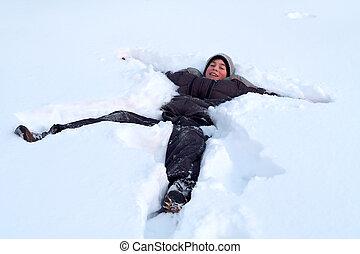 Happy Boy Laying In Fresh Snow