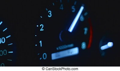 Speedometer movie - sequence of shots of a car dashboard,...
