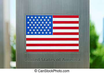 Series of national flags on metal pole - United States -...