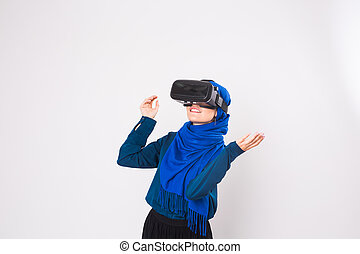 Young muslim woman with virtual reality glasses. Technology,...