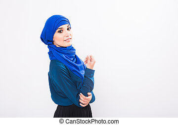 Portrait of young muslim woman wearing traditional arabic clothing