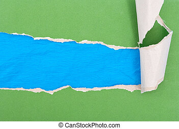 Green torn paper on blue paper