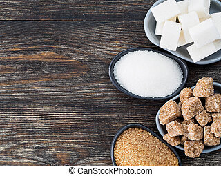 Rushy raw sugar cubes close up - Top view of different types...