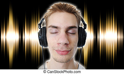 Listening to headphones - Young adult teen listens to music...