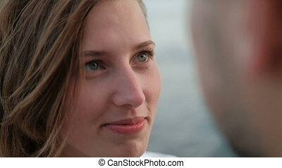 close shot of woman looking at man face rests on fresh air on vacation
