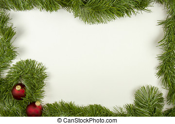 Green garland with red ornaments in frame on white - Green...