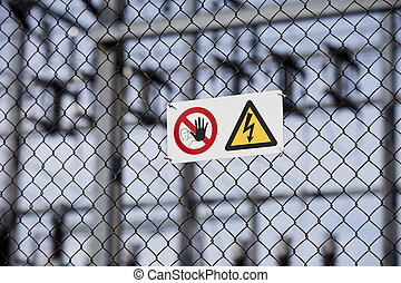 Warning signs on a fence with short focal depth