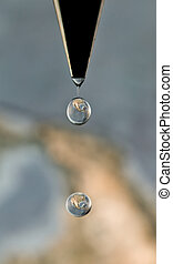 Earth Seen in Drops of Water - Earth can be seen through...