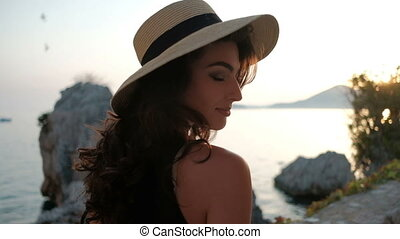 Portrait of passionate brunette in a hat, which looks a...