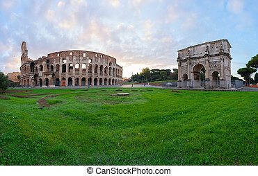 Colosseum at sunset in Rome, Italy - ruins of antique...