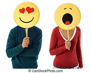 couple with emoticon - young adult woman and man holding...