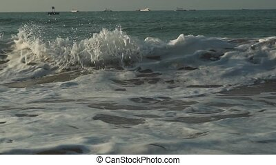 Strong waves at South China Sea on Dadonghai Beach slow...