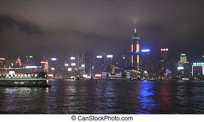 Hong Kong Harbor with Boats at Night u2013 Time Lapse
